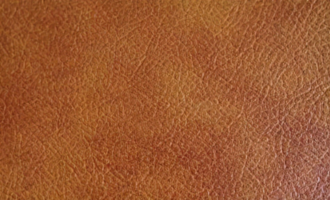 牛剖层移膜革是什么材料(二层牛皮算不算真皮)